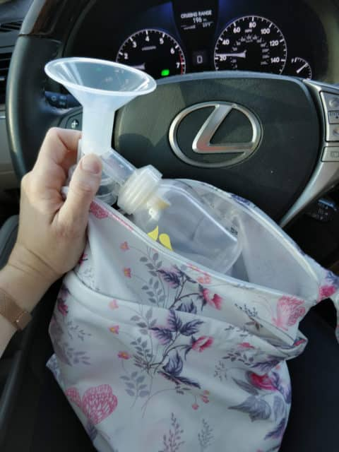 Breast pump parts being placed in wet bag.